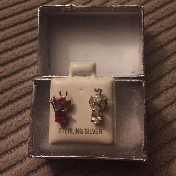 Earrings It's a angel and a devil earring it's still new I haven't used them Accessories