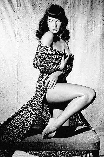 Betty Page - probably the most famous pin-up. Love the hair and her stare.