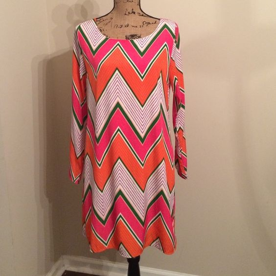 """Fabulous Chevron multicolor dress   Fabulous Chevron multicolor dress // body fully lined // size M // 34"""" length; 24"""" sleeves // colors of the dress are: orange, purple, white, green and hot pink Boutique Dresses"""