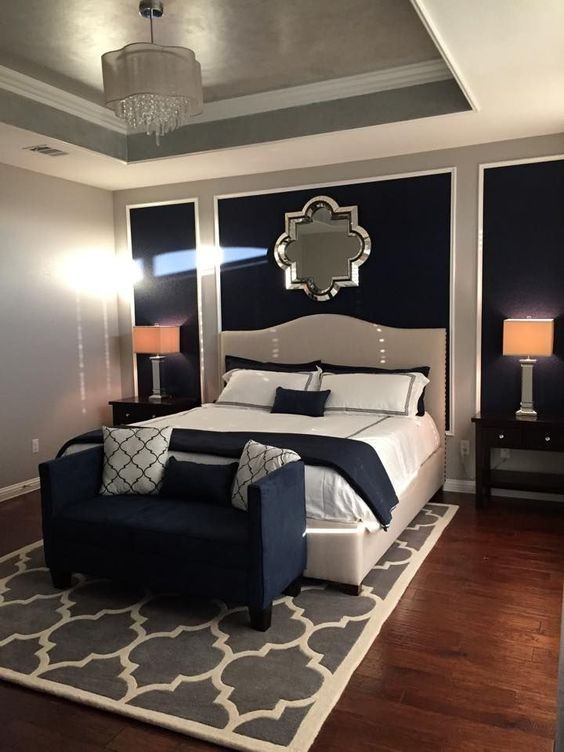 Love the decor and mirror above the bed on a dark wall look
