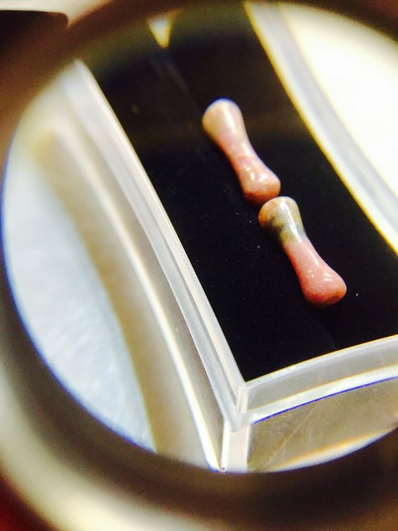 10 Gauge Rhodonite Stone Double Flare Plugs. Lucky 7 Tattoo & Piercing in Kings Beach, CA
