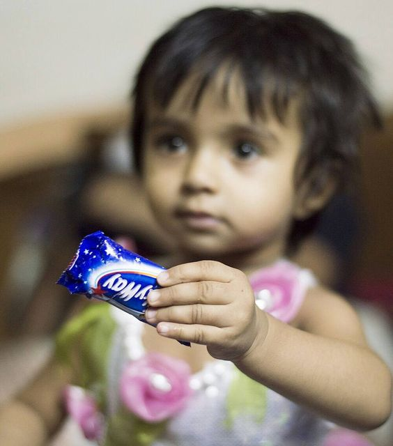 """I won't share my chocolate with you"" Those were her words to me! #nikon #nikontop #50mm #50mmlens #potraiture #portraitoftheday #portraits #portrait #perfection #focus #1.8 #eyes #hands #cute #talnts #chocolate #jj_portraits #jj #jj_allportraits #jaw_dropping_shots #portbox #makepotrait"