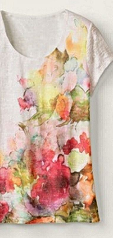 Dress up a plain t-shirt using colored Sharpie markers and rubbing alcohol to obtain a beautiful watercolor effect