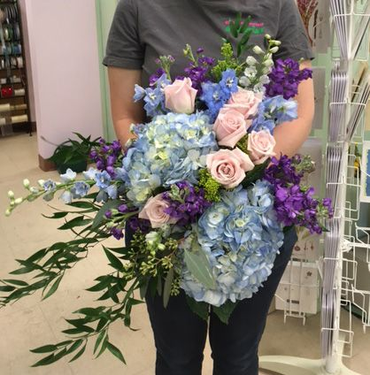 Fairy Tale bouquet in blues, lavenders and blushing pinks.  Enchanted Florist Taos. hydrangea, delphinium, pink roses, lavender stock