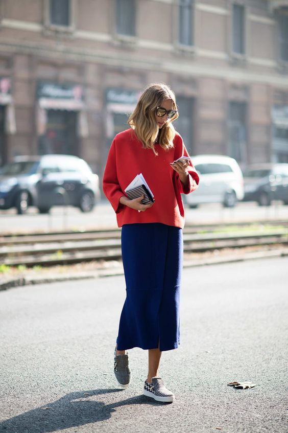 Candela Novembre This combination of red top and blue midiskirt makes primary colors look polished, especially with houndstooth sneakers.   Photo: I'M KOO: