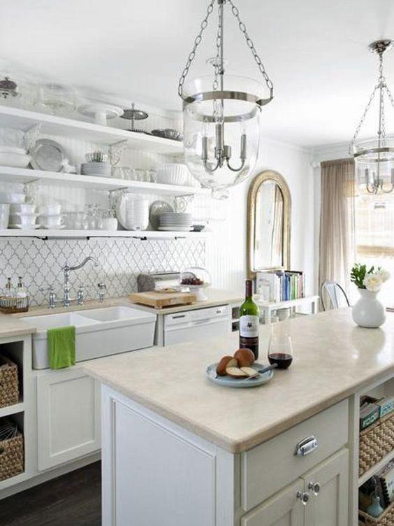 Wicker baskets are a staple storage solution in coastal design.: Backsplash Tile, White Kitchen, Kitchen Design, Light Fixture, Moroccan Tile, Farmhouse Sink
