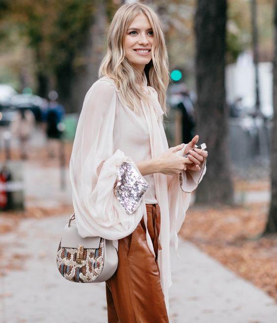 Parisian chic – Lena Perminova arrives at the Grand Palais – Salon d'Honneur for our SS17 runway wearing a flou Chloé blouse and Drew bag