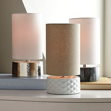 Make a lamp like these from West Elm using a circular cut piece of wood and shiny metalic or white paint?  #DIY