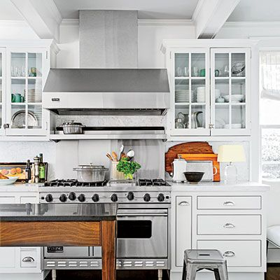 The Kitchen | It's okay to paint everything all one color, but try this formula to add subtle depth and richness: Put the lightest color on the walls, go one shade darker on cabinets, and then go one shade darker than the cabinets on the ceiling. My colors—Benjamin Moore's Horizon, Alaskan Husky, and Sleigh Bells—are all from the same paint card. This approach works especially well with neutrals.