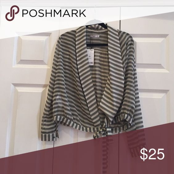 Wrap top from Germany! Super cute wrap top from Germany Mango Tops Blouses