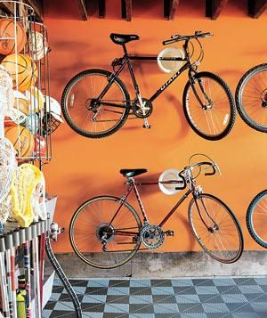 Save garage space by hanging bikes on the wall.