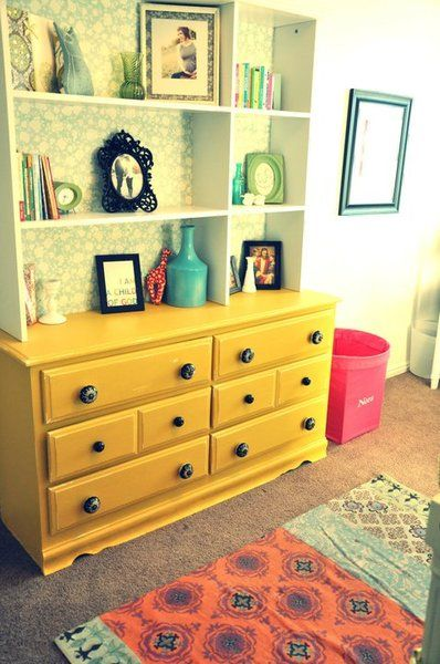 Yellow vintage contemporary dresser - love the pretty wallpaper on the hutch! #nursery