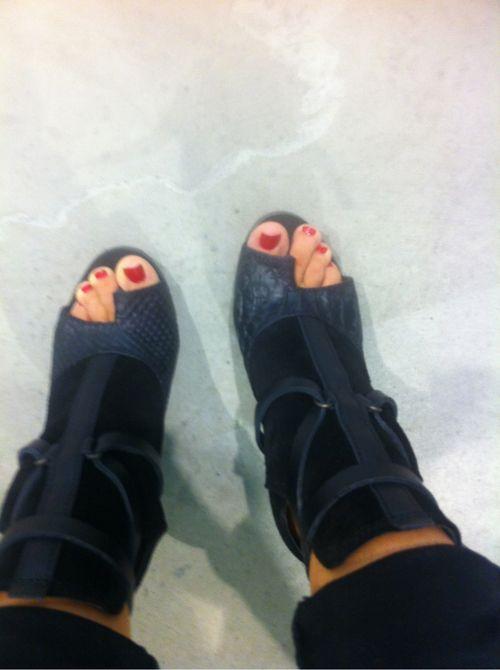 Ksubi booties and red toenails