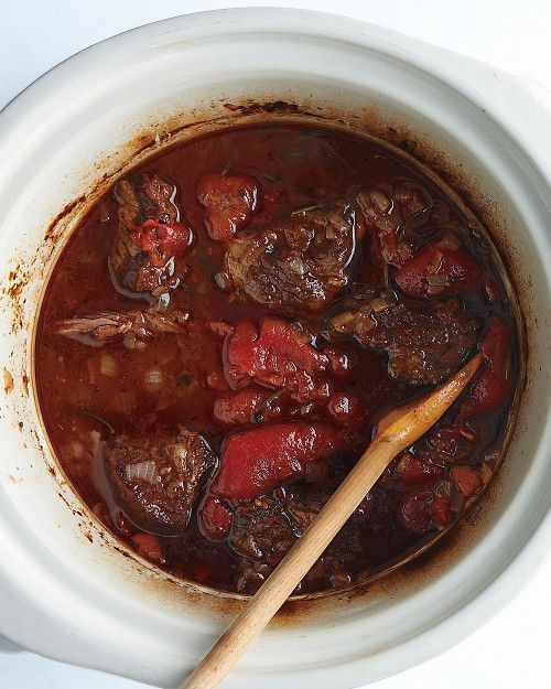 Slow-cooked short ribs with tomatoes, carrots, and onions are ...