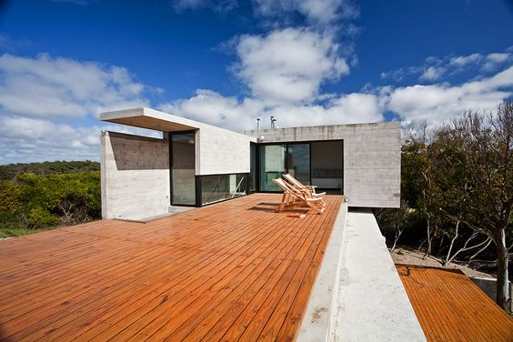 Concrete House With Industrial Features on the Beach by BAK Architects