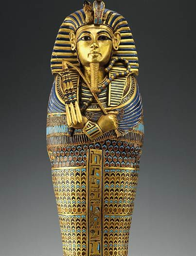 Coffinette for the Canopic of Tutankhamun Gold, carnelian, obsidian, rock crystal, glass Length 39.5 cm (15.5 in); width 11 cm (4.3 in) Dynasty 18, reign of Tutankhamun Thebes, Valley of the Kings Tomb of Tutankhamun (KV62) Carter 266g