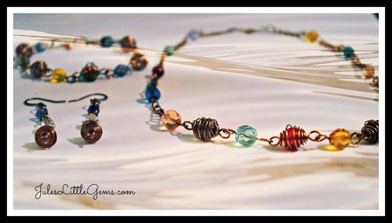 Pretty Czech glass faceted beads wrapped in antique copper wire, necklace,bracelet & earrings.