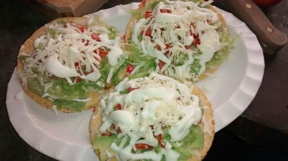 Avocado tostadas. Avocado, lettuce, tomato, cheese, sour cream, salsa.