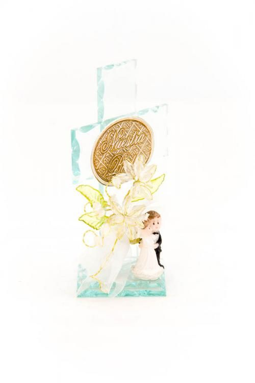 Wedding party favors made up of a glass cross with a Wedding couple figurine and crystal flowers.