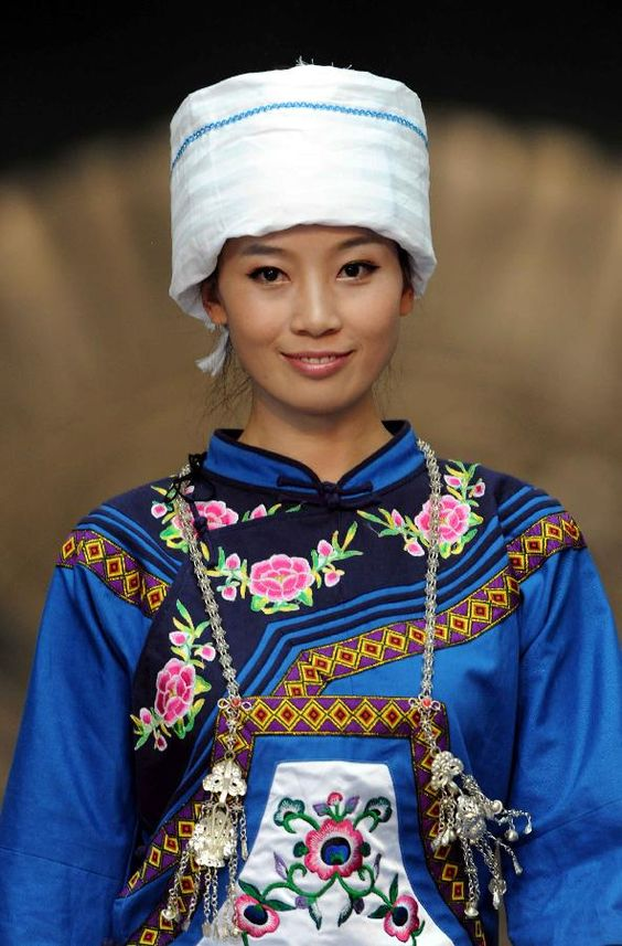 dress and decorations from Maonan ethnic group during a show of traditional costumes in Guiyang, southwest China's Guizhou Province, Sept. 9, 2011.
