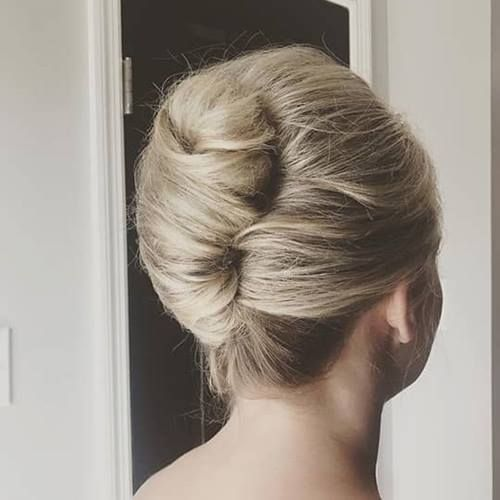 10 Of The Most Iconic 1950s Hairstyles To Recreate In 2021 Hair Com By L Oreal French Twist Hair 1950s Hairstyles Short Hair Updo
