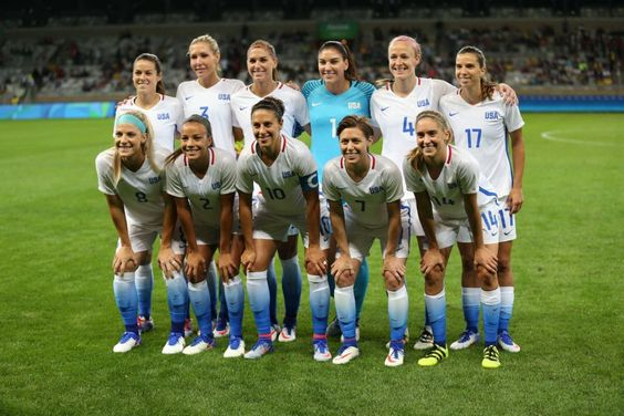 The United States women's national team poses for photos before a match against New Zealand during the 2016 Rio Olympics at the Mineirao Stadium in Belo Horizonte, Brazil, Wednesday, Aug. 3, 2016.