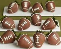 Chocolate covered strawberry footballs.