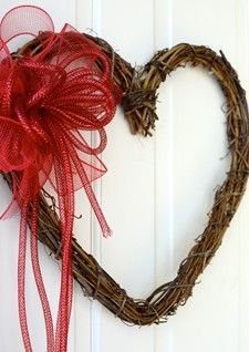 Grapevine heart with red bow
