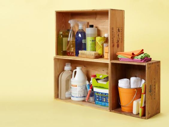 """""""Wine shops usually toss their wood crates, so ask to take some off their hands and stack them to make charming insta-shelves. Fill them with detergents, cleaners and towels."""" — David Bromstad, Color Splash"""