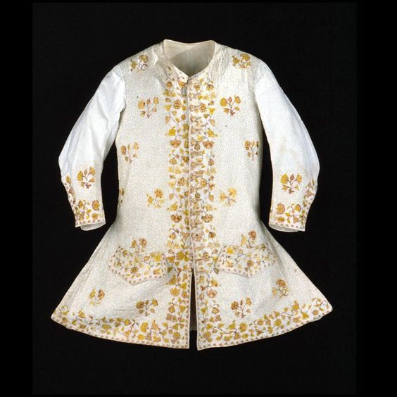 Long-sleeved waistcoat, Engladn, 1700-1720. Silk needlework on tabby linen. Design consists of floral sprigs and concentrated flowers around edges, with vermicelli embroidered ground.