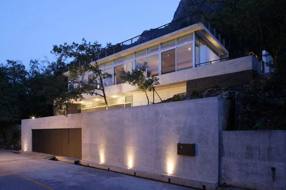 Architecture, Exterior Modern Open House Lighting Ideas With Iron Gate And Cement Wall: The Elegant House with an Impeccable Design in Nuevo...