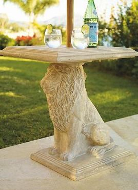"Provide shade to your guests with the help of the Lion Umbrella Table; a regal and all-weather stone composite piece designed to securely hold an umbrella with up to a 2"" diameter pole."