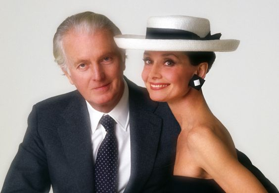 The French fashion designer Hubert de Givenchy photographed with his muse Audrey Hepburn by Joe Gaffney at the Maison Givenchy, on Avenue George V, in Paris (France), specially for a catalog celebrating the 30 years of Maison Givenchy, in February 1983.: