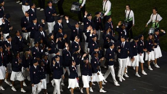 LONDON, ENGLAND - JULY 27: Athletes from the United States delegation wave as they parade during the Opening Ceremony of the London 2012 Olympic Games at the Olympic Stadium on July 27, 2012 in London, England.  (Photo by Paul Gilham/Getty Images)