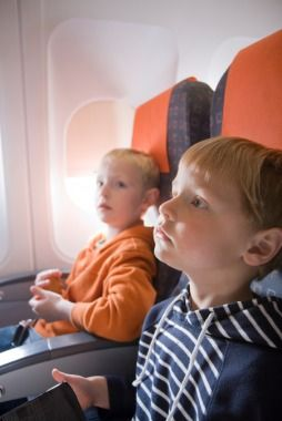 50 Ways to Entertain a Kid on an Airplane, there's some really good ideas! I will probably need this soon!
