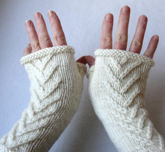 Knitting Pattern for Nottingham Fingerless Mitts - These gauntlets feature an easy twig pattern that resembles arrowheads.