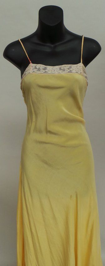 Four 1920's/30's slips in mixed vintage condition. : Lot 494
