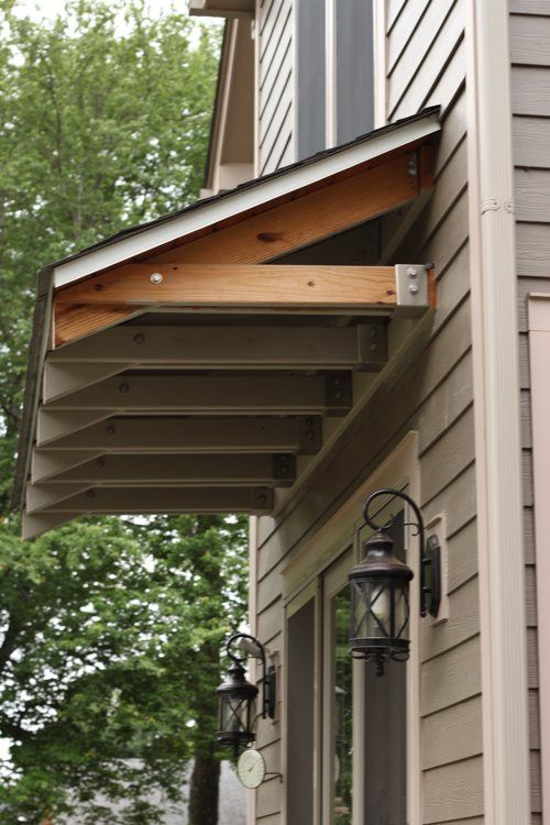 Garage door overhangs how to build awning over door if for Front door roof designs