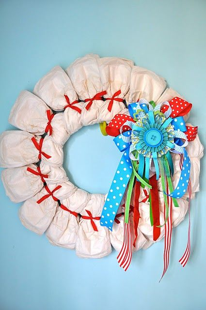 How to make a diaper wreath. A fun alternative to diaper cakes for baby showers.