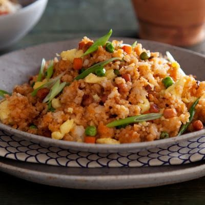 Yangzhou Fried Rice is Shanghai's most popular dish and entails shrimp, mushrooms, ham, and peas. I actually use fine cubed ham and serve with two fried eggs over the top, which is how I got it in China, Also steamed chinese sausage is good also.......John