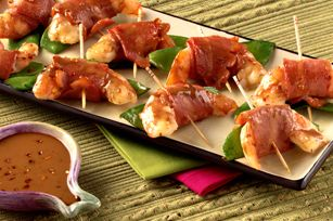 ASIAN-STYLE TURKEY BACON APPETIZERS **What You Need** 8 uncooked medium shrimp, peeled, deveined -- 16 snap peas -- 8 slices turkey bacon, cut crosswise in half -- 1/2 cup Kraft Asian Toasted Sesame Dressing **Make It** HEAT oven to 400ºF. CUT shrimp lengthwise in half. Place 1 shrimp piece on each snap pea; wrap with bacon piece. Secure with wooden toothpicks. Place in single layer in shallow pan sprayed with cooking spray. BAKE 10 to 12 min. or until shrimp turn pink. Discard toothpicks…