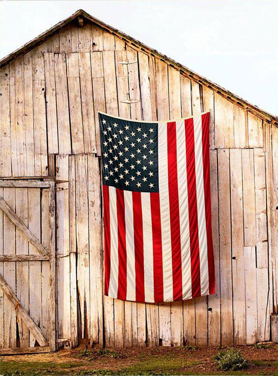 American Flag on an old barn.: