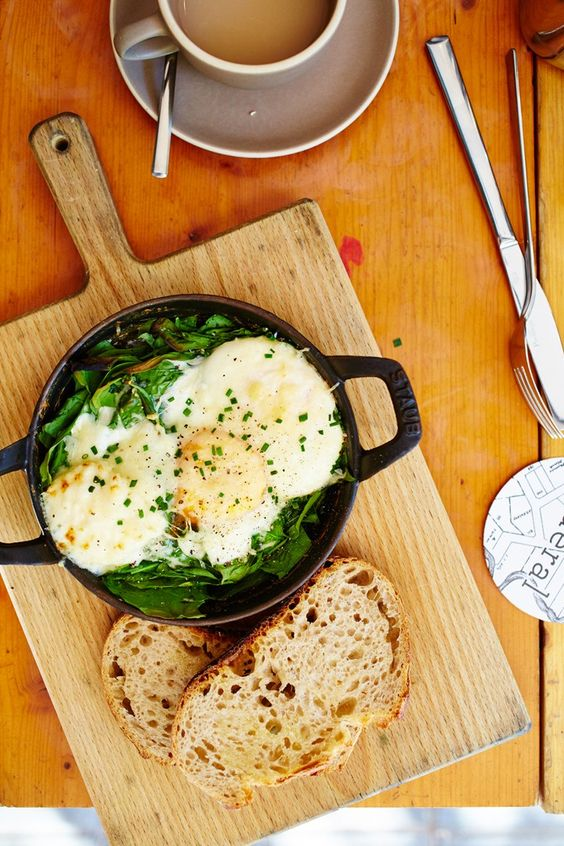 Eggs Florentine (cooked to perfection in a Staub cast iron pan), on a bed of babyleaf spinach and served with sourdough toast at Federal Café in Barcelona, Spain. Photo by: David Loftus