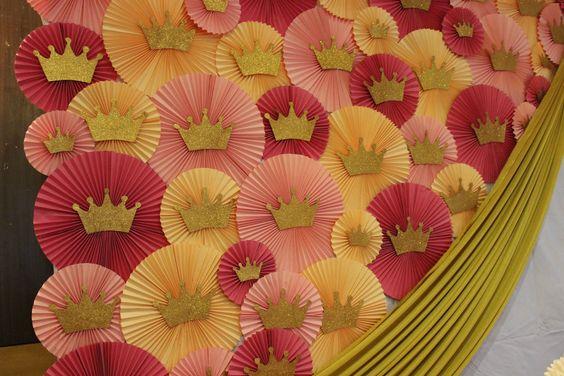 pink peach combination , rosette backdrop , princess theme , glitter gold crowns , paperfans , rosettes