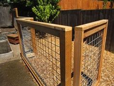Nates play yard gravel dirt area fence, to keep the dogs out