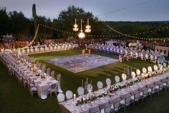 Although I've never really likes the idea of long dining tables for a reception, I really love the layout of this glamorous this outdoor reception.