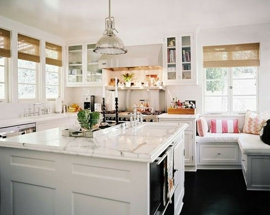 i love everything about this kitchen. white cabinets, white countertops, black floors, bamboo shades, window seat, silver touches, splash of color with a touch of black accents thrown in = my dream kitchen!!