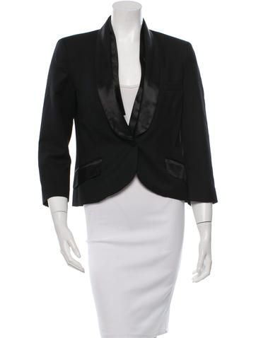 Black McQ by Alexander McQueen wool blazer with dual flap pockets at hips and single button closure at front.