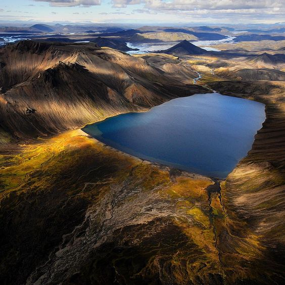 """""""Landmannalaugar's volcanic landscape, Iceland in afternoon light from a helicopter.  One of my favorite spots and a creative haven for any  photographer.…"""""""