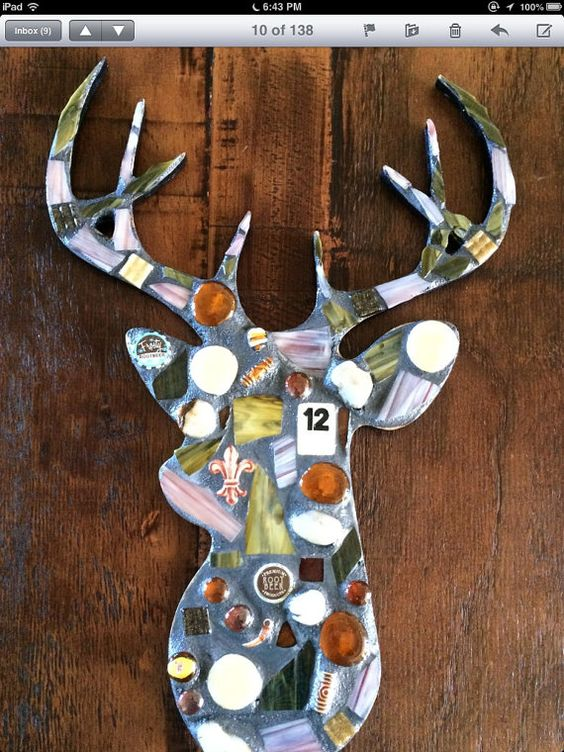 Rustic buck deer. Whimsical. Stained glass, glass gems. Comes ready to hang. For indoor or outdoor. Measures 21 inches tall, 13 1/2 inches wide, 1
